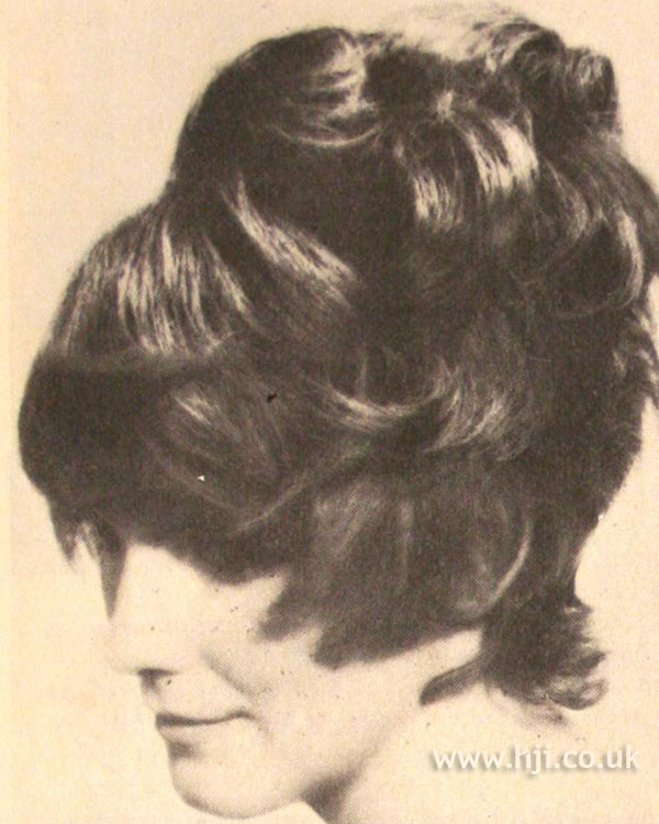 Short 1970s bouffant with sweeping fringe