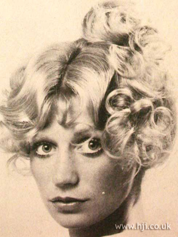 1970s curly blonde updo with fringe