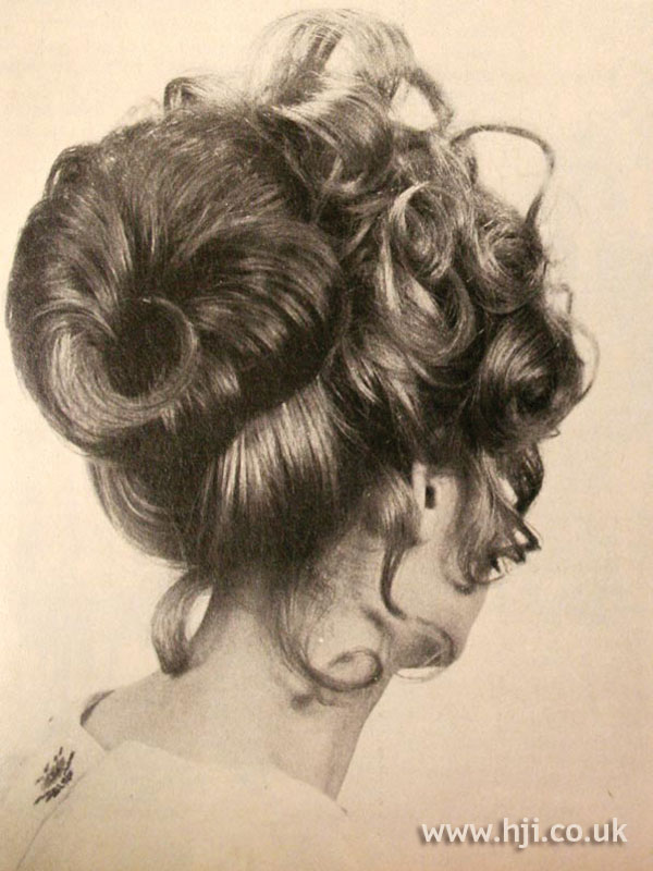 1970s curly topknot hairstyle