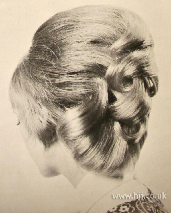 1970s curly updo hairstyle