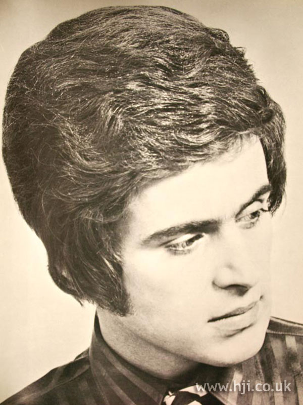 1970s men's wavy hair with fringe