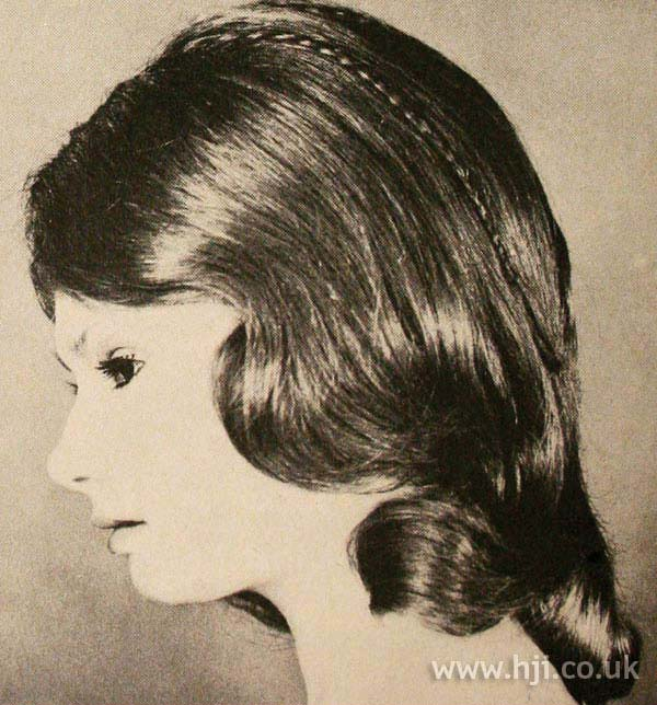 1970s wavy hairstyle with plait