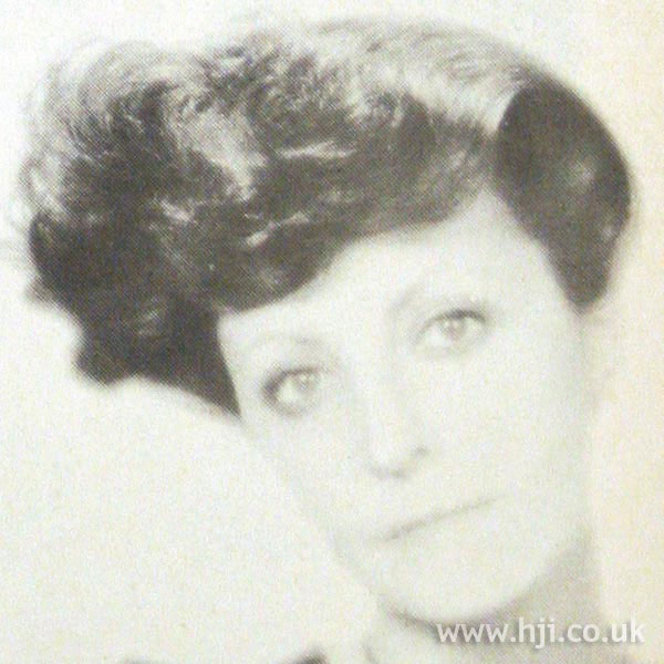1970s updo with large asymmetric roll