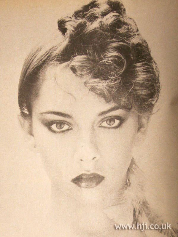 1979 asymmetric updo hairstyle