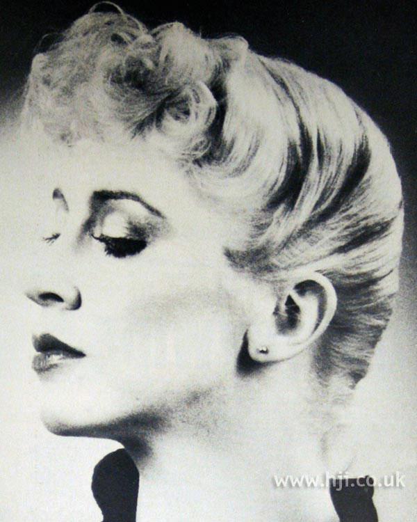 Sweeping 1970s blonde updo