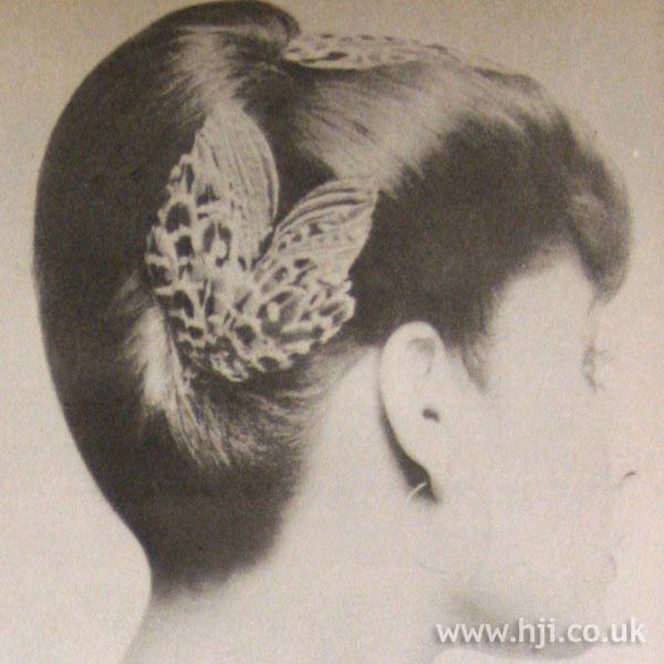 Sleek 1970s chignon with hair accessories