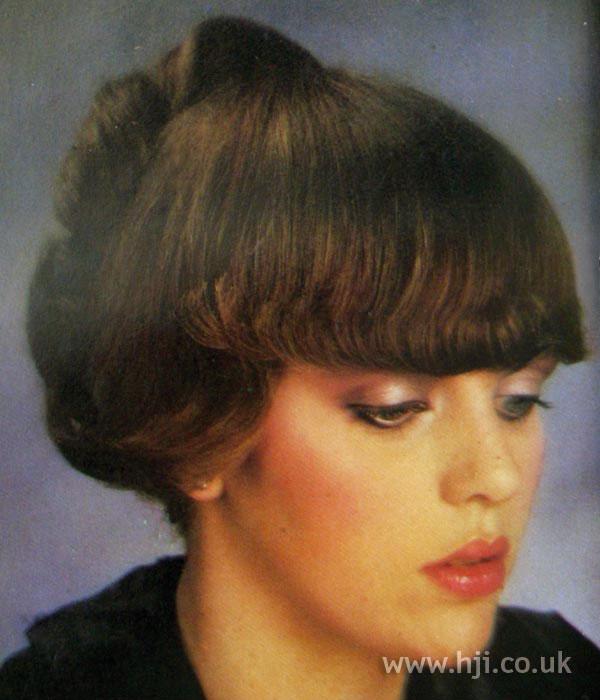 1970s chignon with full fringe