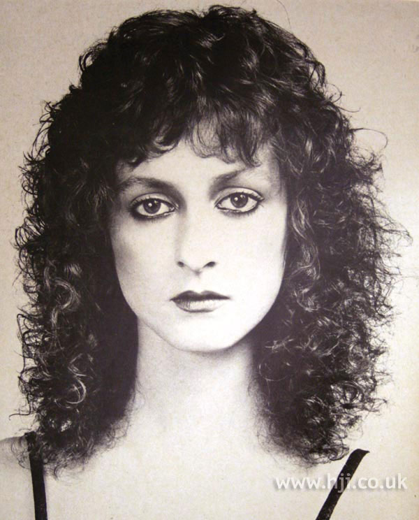 1979 brunette permed hairstyle