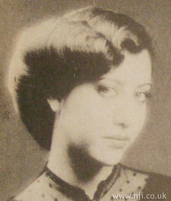 1970s side-parted roll hairstyle