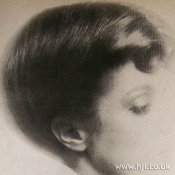 Sleek 1970s rolled updo
