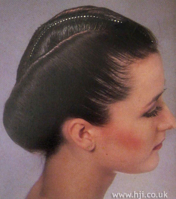 Sleek 1970s chignon with haircombs