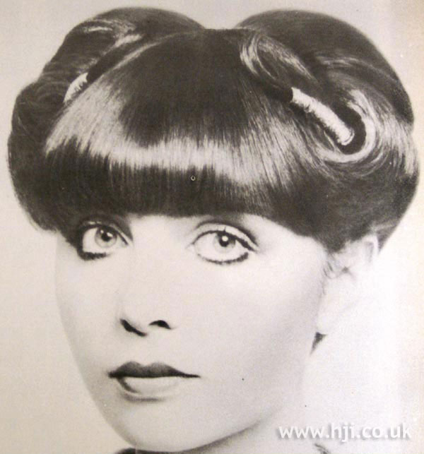 1970s twisted updo with full fringe