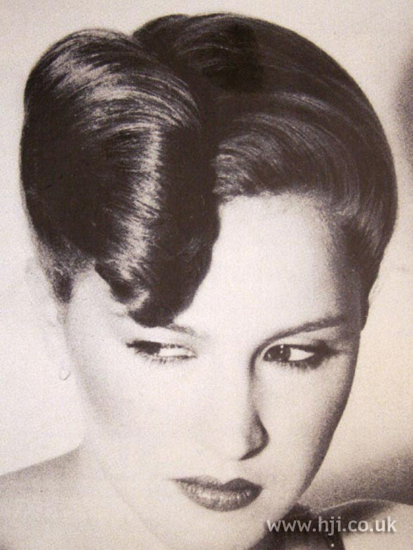 1970s rolled chignon hairstyle