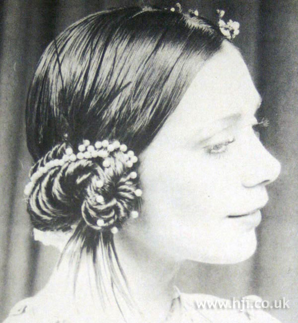Sleek 1970s updo with hair accessories
