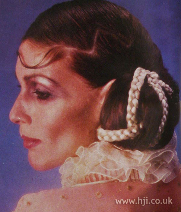 1970s sleek updo with braided detail