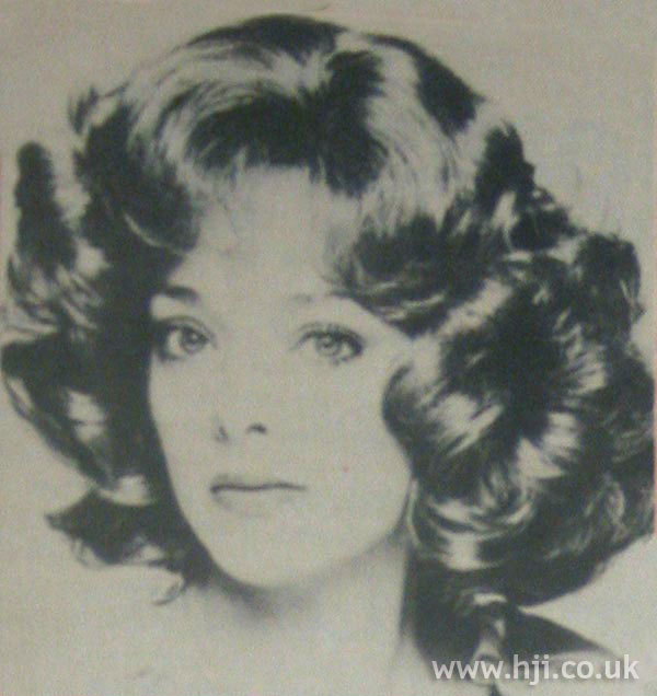Full 1970s side-parted curls