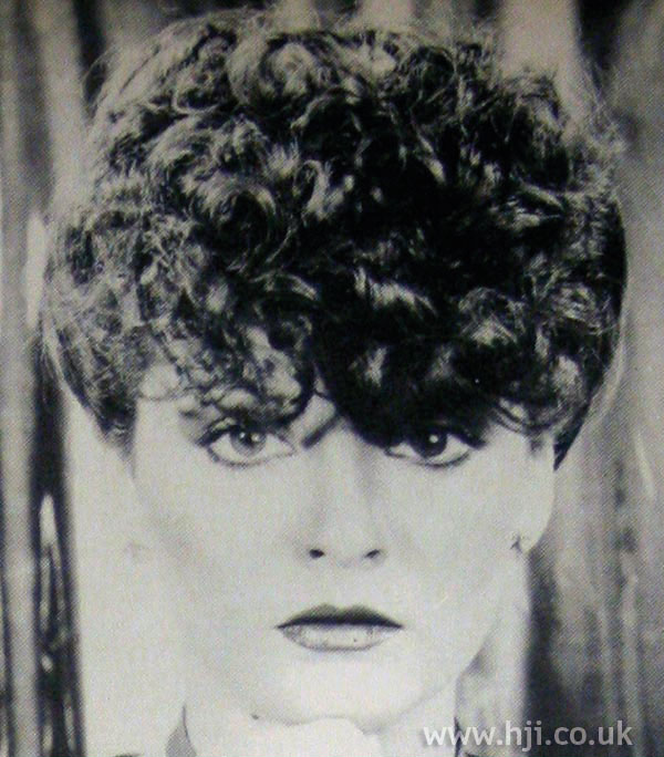 1970s hairstyle with curly quiff