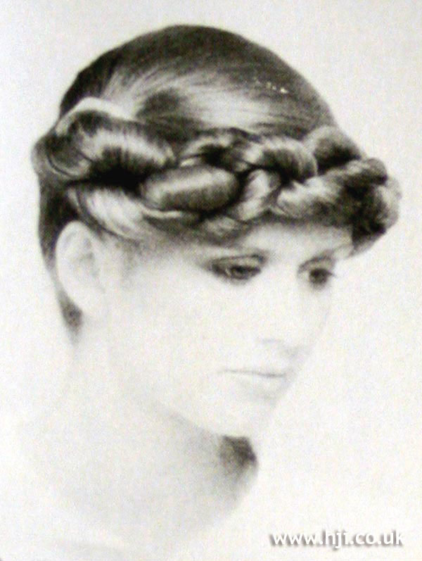 1970s sleek updo with plaited detail