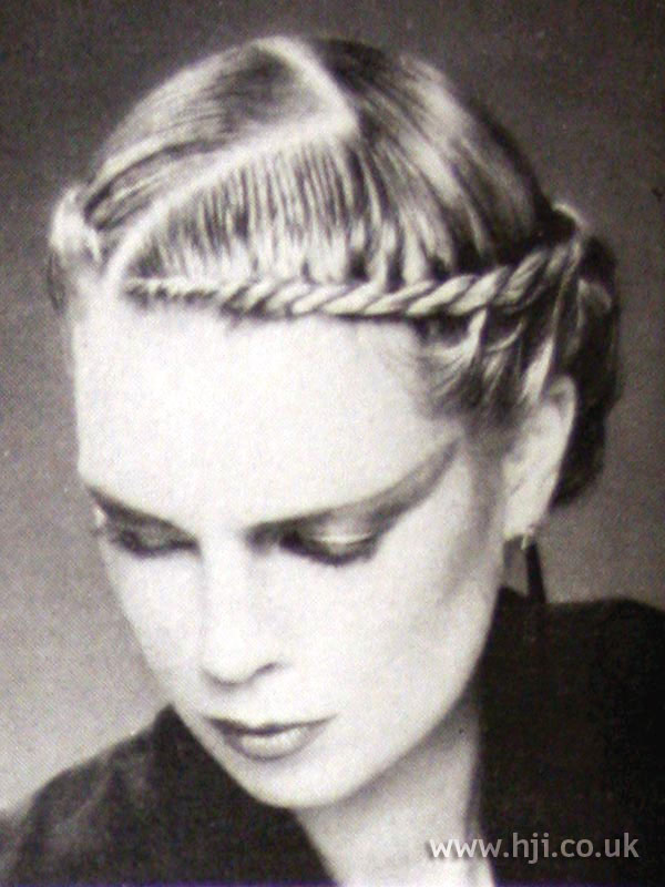 Sleek 1970s hairstyle with zig-zag parting