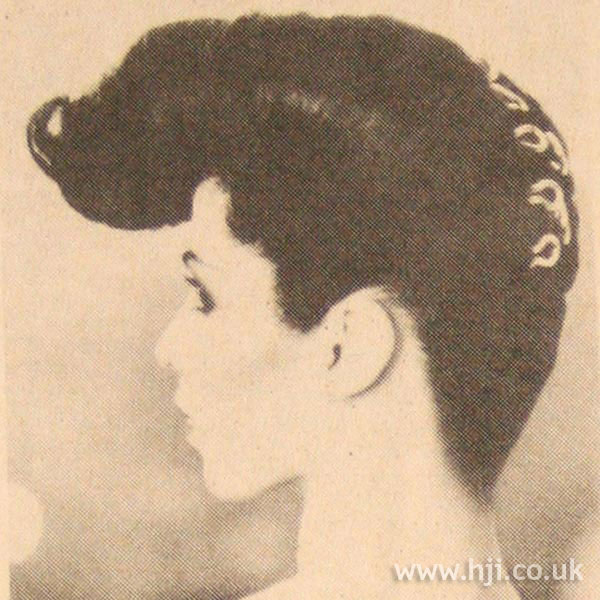 1970s exaggerated quiff hairstyle