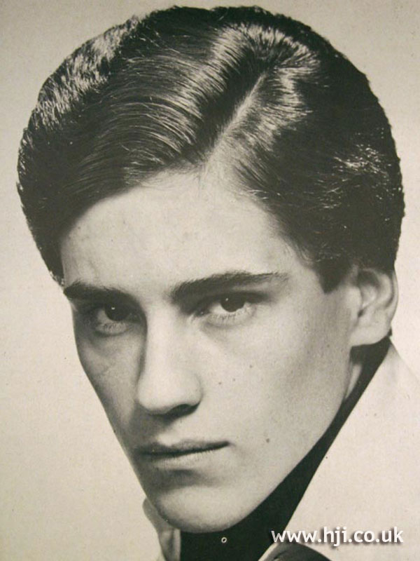Sleek 1970s men's cut with side parting