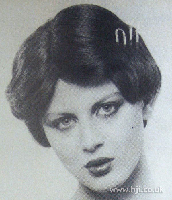 1970s chignon with hair pin detail