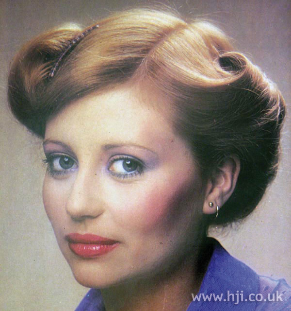 1970s side-parted updo with rolls