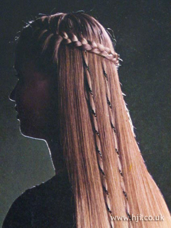Straight 1970s hairstyle with braids