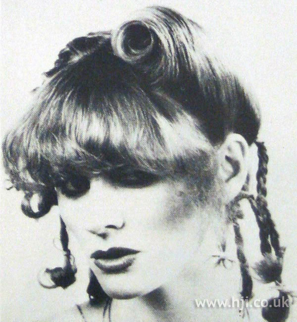 1970s updo with rolls and plait details