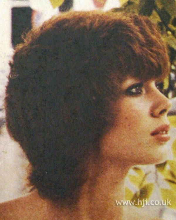 Layered 1970s red bob hairstyle