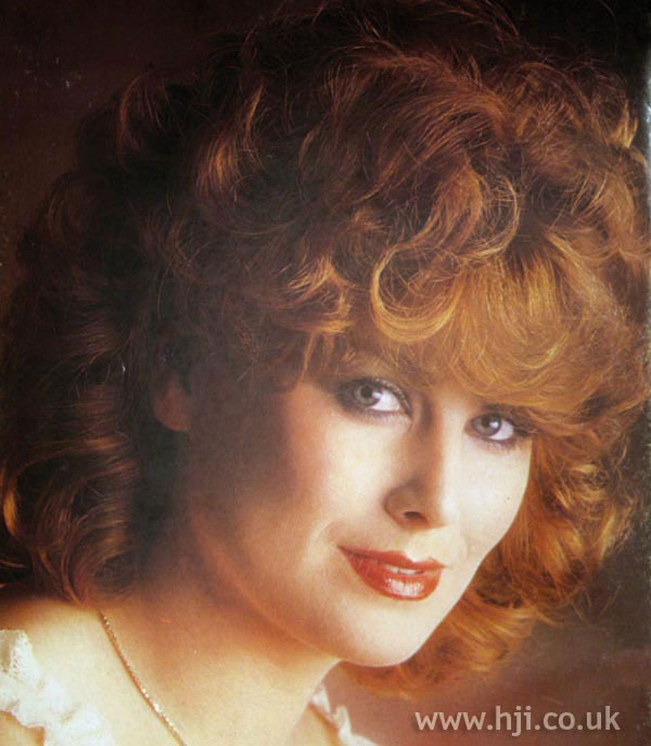 1970s red permed hair