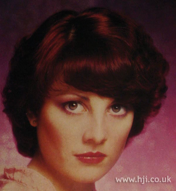 Long 1970s red bob with fringe