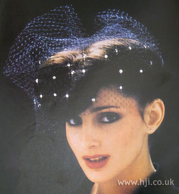 1970s double roll hairstyle with veil
