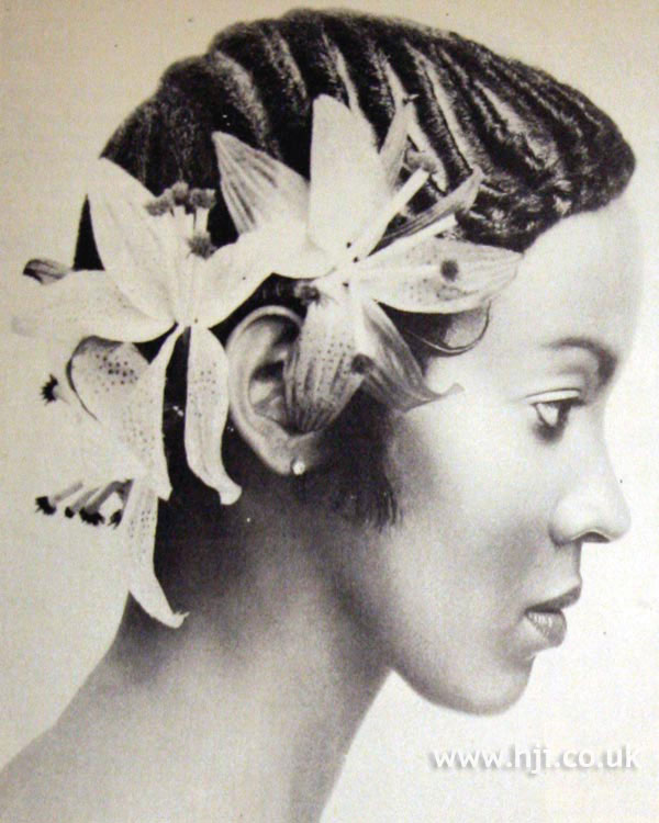 1970s cornrows with flower accessory