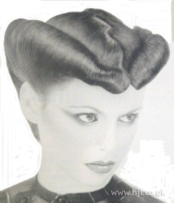 1979 sculpted updo hairstyle