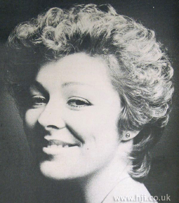 Short 1970s permed hairstyle