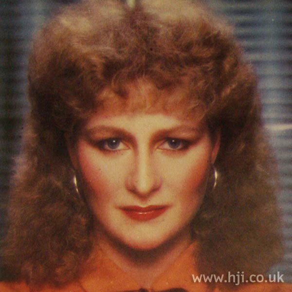 1970s red perm with fringe