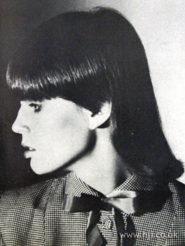 1979 straight brunette hairstyle