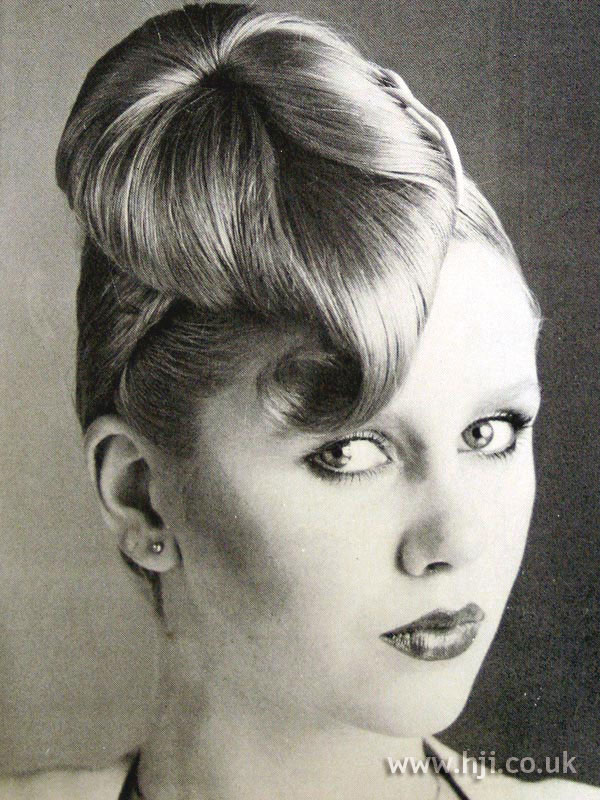 Sleek 1970s updo with topknot