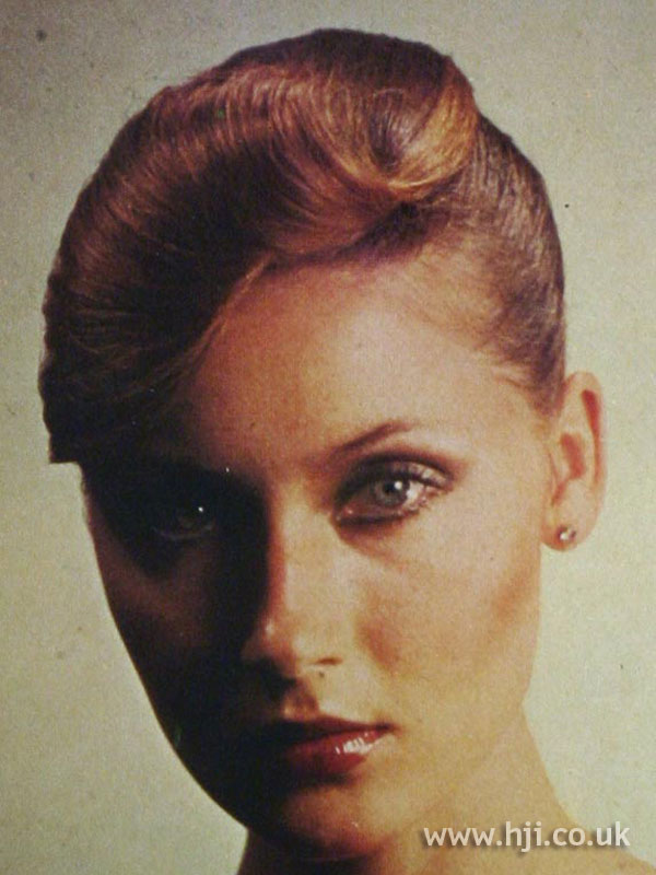 1970s updo with sweeping fringe