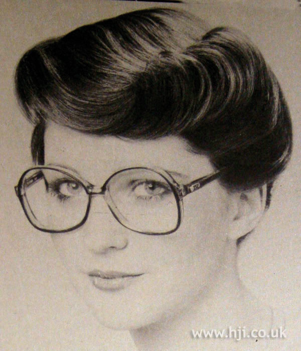1970s asymmetric roll hairstyle