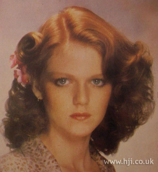 Side-parted curly red 1970s hairstyle
