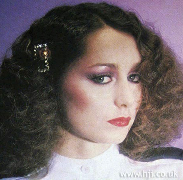 1970s curls worn with hair accessory