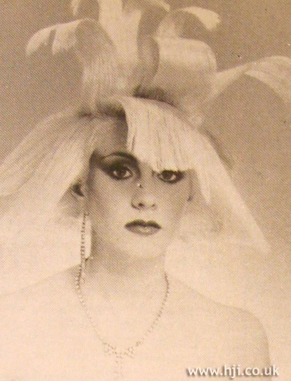 1984 blonde avant garde hairstyle