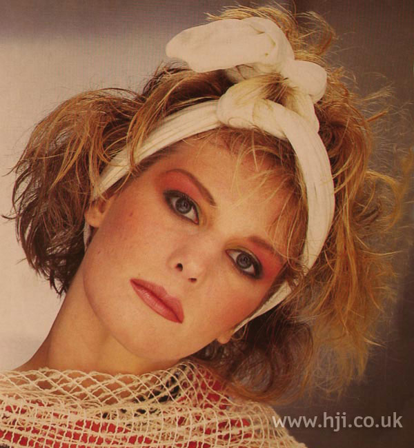 1984 blonde textured hairstyle
