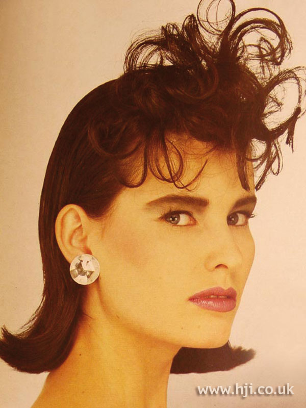 1984 curly fringe hairstyle