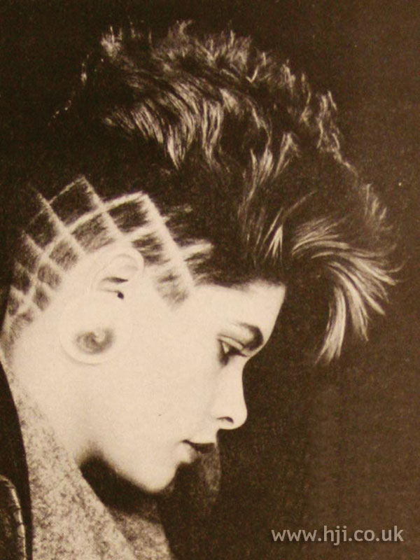1984 cropped hairstyle with graphic shaved sides