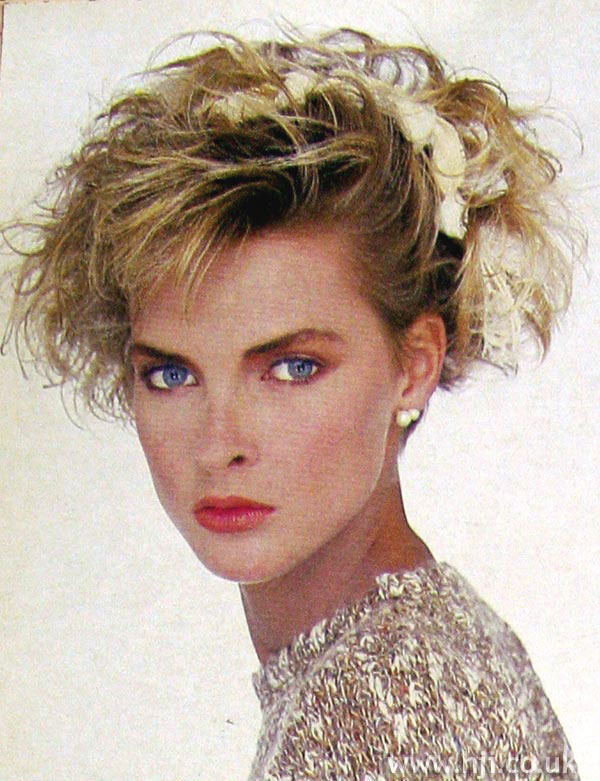 1984 updo blonde hairstyle