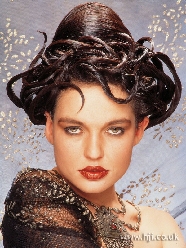 1985 sleek avant-garde updo hairstyle