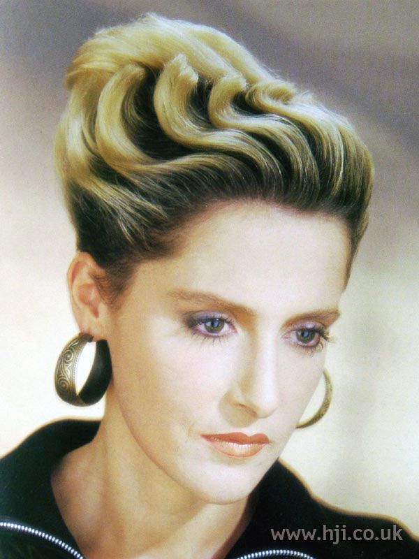 1987 blonde chignon with waves